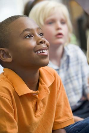 Kid in Orange Shirt at Preschool